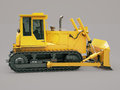 Heavy crawler bulldozer on a gray background Stock Photography
