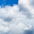 Heavy cumuli clouds in blue sky summer day Stock Image