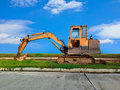 Heavy duty construction equipment parked at worksite Stock Photos