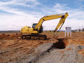 Heavy duty construction equipment by work site Royalty Free Stock Photo