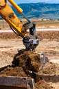 Heavy duty construction excavator loading sand into a dumper truck Stock Image