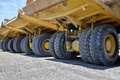 Heavy equipment industrial dump trucks manufactured for construction and road work and mining industry business Royalty Free Stock Images