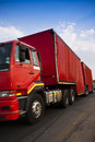 Heavy goods in transit red lorry cross country transportation a huge industry many lands that have long distances between cities Royalty Free Stock Photography