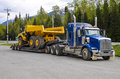 Heavy hauling of a big tipper truck on a low loader trailer Royalty Free Stock Photo