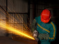 Heavy industry manual worker with grinder 03 Stock Images