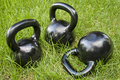 Heavy kettlebells in grass Stock Photo