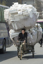 Heavy load on bike in china transportation with Royalty Free Stock Photo
