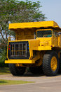 Heavy mining truck in mine and driving along the opencast. Photo of the big mine truck, The career heavy-load super car Royalty Free Stock Photo