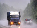 Heavy rainstorm chelyabinsk region russia july blue zil flatbed truck at the interurban road during a Stock Photos