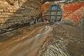 Heavy rusty water flap water flow brick wall Stock Image