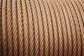 Heavy steel coiled greased cable detail in warm tone Royalty Free Stock Photo