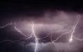 Heavy summer storm bringing thunder lightnings and rain in spring Stock Photos