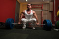 Heavy weight deadlift bodybuilder preparing for of barbell Royalty Free Stock Image