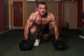 Heavy weight deadlift a bodybuilder is standing and preparing with dumbbells concentrating for a Stock Photo