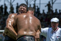 A heavy weight wrestler grimaces whilst competing at the elmali turkish oil wrestling festival in elmali turkey is town Royalty Free Stock Image