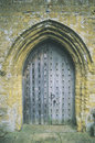 Heavy wooden door under archway at an English church Royalty Free Stock Photo