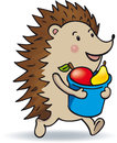 Hedgehog is running and bears fruits Royalty Free Stock Images