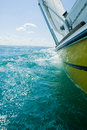 A heeling yellow sailboat Stock Images