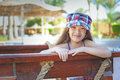 Heerful girl in dress little cheerful on background of egyptian hotel Royalty Free Stock Photo