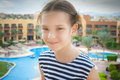 Heerful girl in striped vest little cheerful on background of egyptian hotel Stock Image