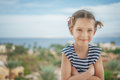 Heerful girl in striped vest little cheerful on background of egyptian hotel Royalty Free Stock Image
