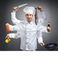 сhef with many hands humorous portrait of a chef gray background Royalty Free Stock Photos