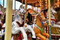 Horses of antique carousel as part of traditional Christmas market in Heidelberg city center