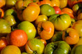 Heirloom tomatoes closeup at a farmers market Royalty Free Stock Photography