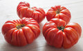 Heirloom tomatoes organic on kitchen table Royalty Free Stock Photo