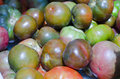 Heirloom tomatoes varieties of for sale in the market Stock Photo