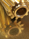 Helical gears steampunk on scratched reflective surface Royalty Free Stock Images