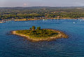 Helicopter aerial shoot of small island near pula istria croatia Royalty Free Stock Photo