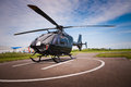 The helicopter in airfield parked at helipad Stock Photos