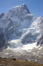 Helicopter below mountain a lands a great white himalayan very high altitude Stock Photography