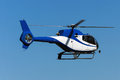 Helicopter a blue painted flying in the air Royalty Free Stock Image