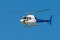 Helicopter a cruising against a blue sky Royalty Free Stock Photos