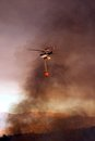 Helicopter with fire bucket, Spain. Royalty Free Stock Photo