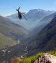 The helicopter flies in mountains Royalty Free Stock Image