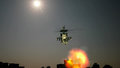 Helicopter flying with explosion in front Royalty Free Stock Photo