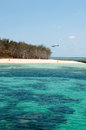 Helicopter lands beach green island near cairns Stock Photo