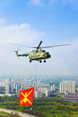 Helicopter with military flag over Moscow Royalty Free Stock Photography