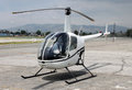 Helicopter parked on ramp a small white Stock Images