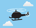 Helicopter silhouette in the sky with clouds Royalty Free Stock Photos