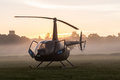 Helicopter at sunrise a on the countryside field early mist with dew on the windows Stock Photography