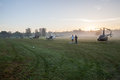 Helicopters field mist morning on the countryside early at sunrise ready for sporting event Stock Photography