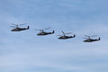 Helicopters a group of military flying on the background of blue sky Stock Photo