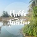 Hello Adventure written on blurred background