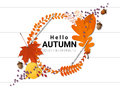 Hello autumn background with decorative wreath on wooden board