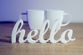 Hello with Coffee Mugs Stock Photos