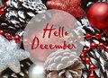 Hello December.Christmas decoration with fir tree toys and pine cones.Winter holidays concept. Royalty Free Stock Photo